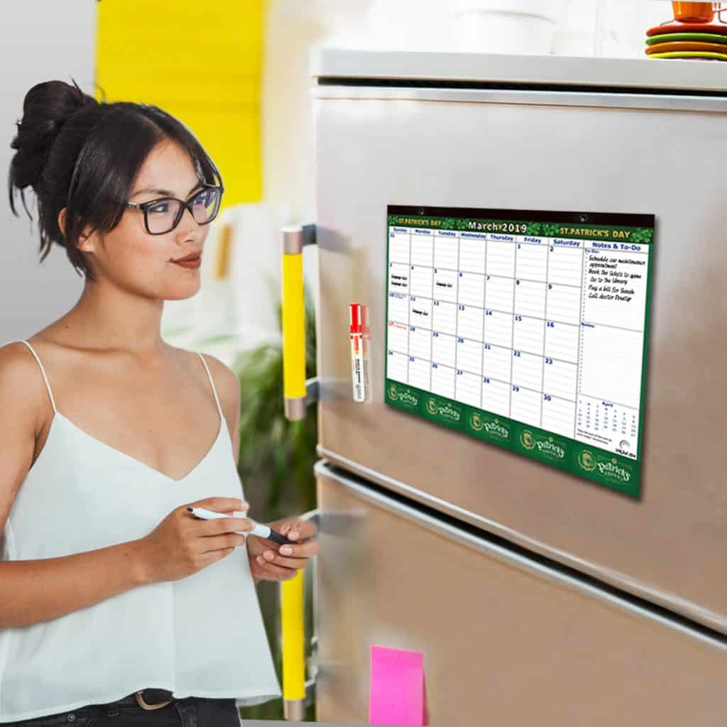 woman looking at her schedules on the large magnetic calendar