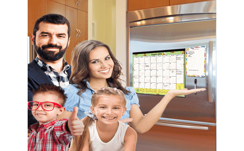 mom dad and kids beside the large magnetic calendar with free dry erase notepad