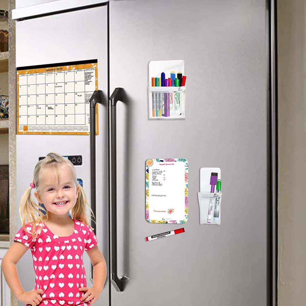 young girl beside a fridge with a magnetic pen holder and magnetic dry erase notepad