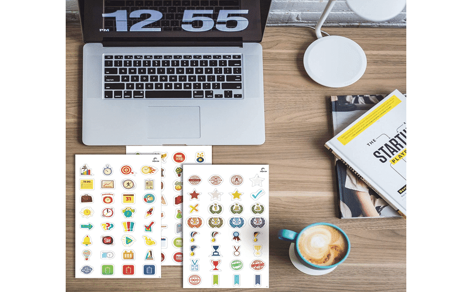 stickers pack for planners on the table with laptop and a cup of coffee