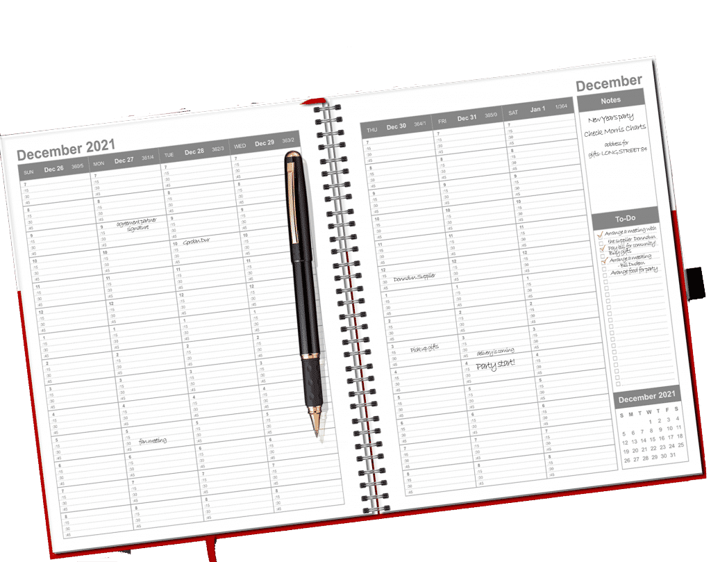 weekly and monthly planner with a pen where you can write your goals