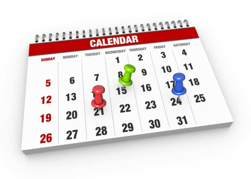 desk calendar and three pins